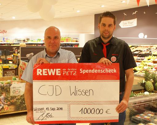Petz-Mitarbeiter spenden 1.000 Euro für das Christliche Jugenddorf